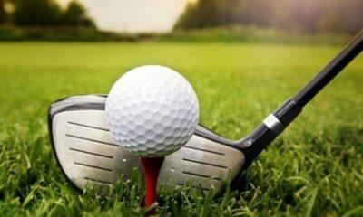 Golf club against a golf ball on a tee