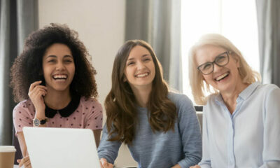 Three women looking at a laptop