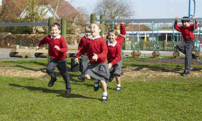 Group of young children playing in school uniform