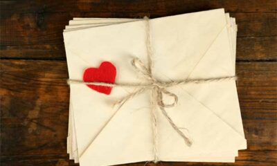 A tied up bundle of letters with a heart