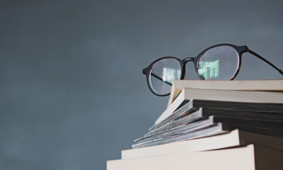 Spectacles on top of a pile of books