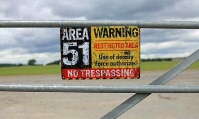 gate with warning sign saying AREA 51 restricted area