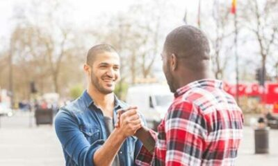 2 men greeting each other in the street