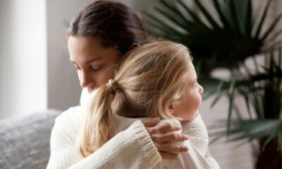 a woman hugging her young daughter