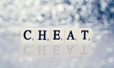 Scrabble tiles on cloud background: CHEAT
