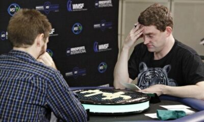 2 men playing scrabble in a tournament