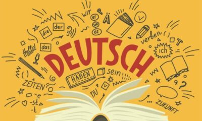 open book with DEUTSCH written above it, and black letters and symbols on a yellow background