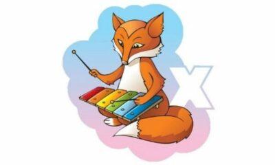 a cartoon fox playing a xylophone