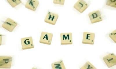 Scrabble tiles with GAME in centre