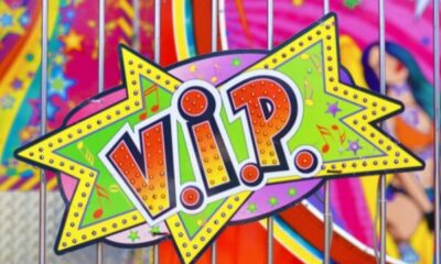 brightly coloured VIP sign