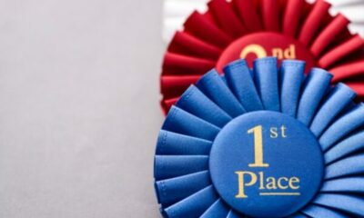a blue rosette showing first place and a red rosette showing second place