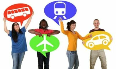 4 people, each holding up a sign for different type of transport: bus, plane, train, car