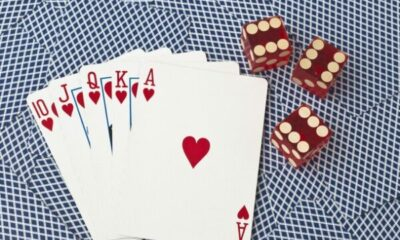 10, J, Q, K, A playing cards with 3 die showing sixes
