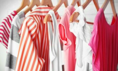 a row of white, pink and red/white striped clothes on hangers