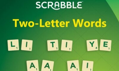 Green background with Scrabble with Two-letter words written on it