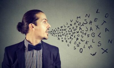 profile of a man with open mouth, and a stream of letters coming out