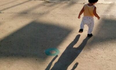 small toddler casting a very long shadow