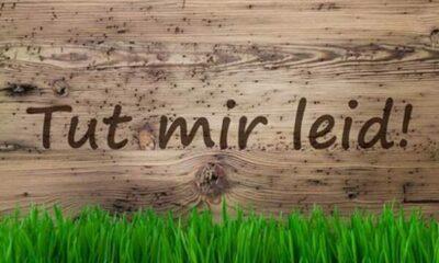Tut mir leid! written on a wooden board