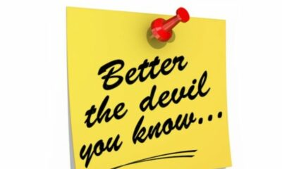 a yellow post-it with better the devil you know written on it