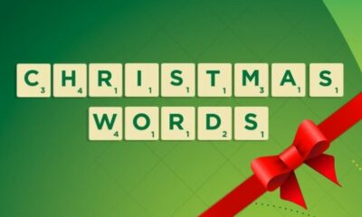 Scrabble tiles: CHRISTMAS WORDS and a red bow