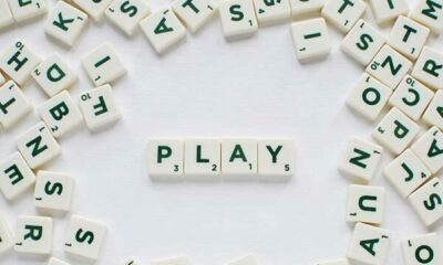 scrabble tiles with word PLAY spelt out