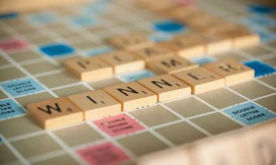 scrabble tiles on board with tiles WINNER placed